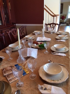 This year's Passover table. Not all the place settings match.